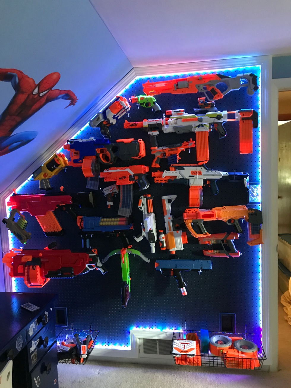 ... Nerf guns, so me and my dad built a Nerf armory. As you can see, it has  cool LED lights. Currently, I have 29 Nerf guns and will be getting more  soon.